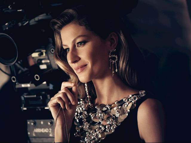 The film was produced, conceived, and directed by filmmaker Baz Luhrmann with production design by Oscar-winner Catherine Martin, and stars supermodel Gisele Bündchen