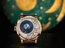 The orbital moon-phase display of this timepiece is calculated with such accuracy that it takes 1,058 years to deviate by one day