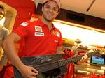 Felipe Massa tests out the Ferrari Blackbird Guitar at Ferrari Maranello Store