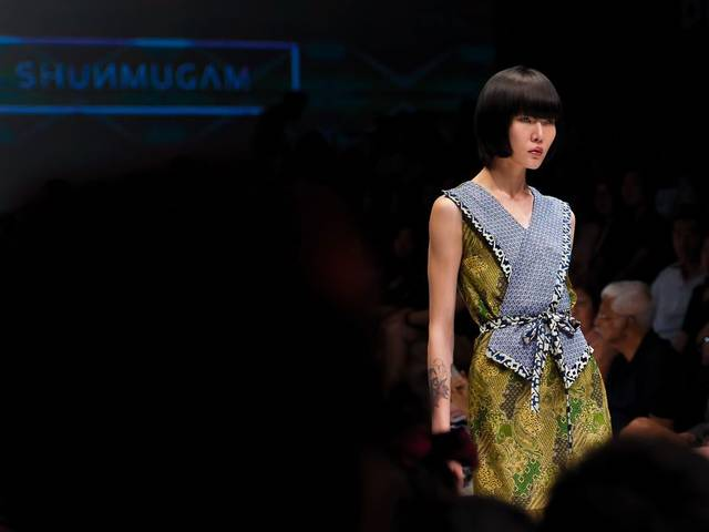 Singapore label ONG SHUNMUGAM showcased its Fall Winter 2014 collection at Audi Fashion Festival, inspired by the architectural heritage of the country
