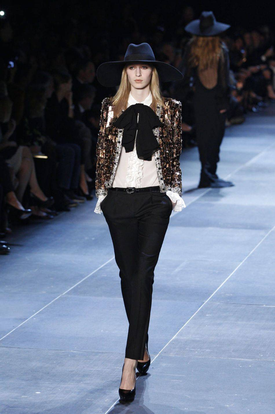 Hedi Slimane looked to the '70s for inspiration for his highly anticipated debut Saint Laurent collection