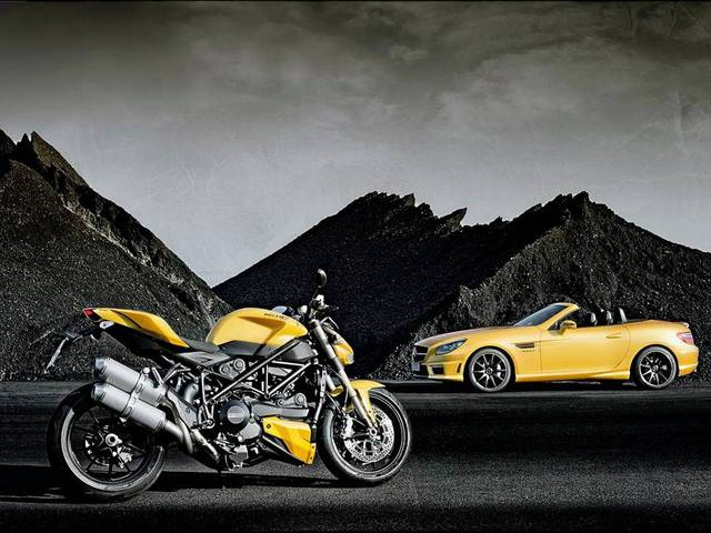 "The SLK 55 AMG and Ducati 848 in ""Streetfighter Yellow"" on display at the Bologna Car Show"