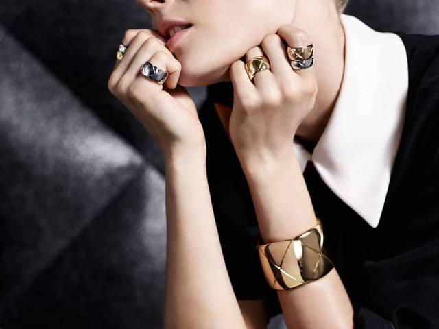 The limited-edition, six-piece collection comprises five rings and a cuff in 18-carat white and yellow gold, finely engraved with the maison's iconic quilting pattern