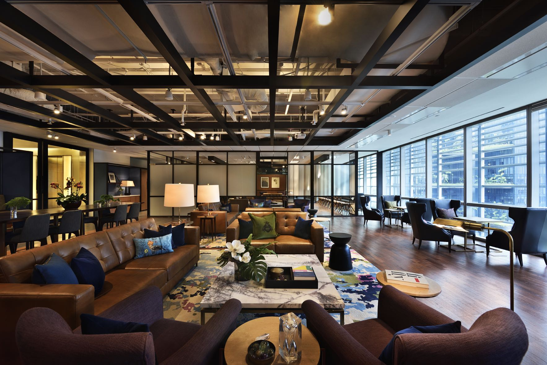 The great room brings touch of designer hotel luxe to co for Well designed office spaces