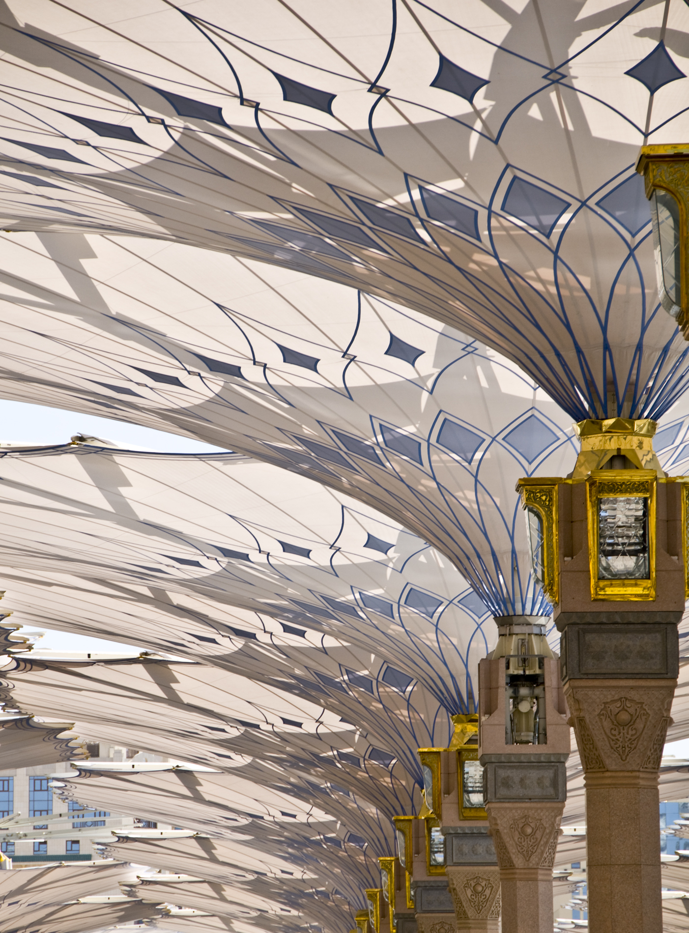 The giant umbrellas that protect pilgrims at the medina for Architecture upbrella