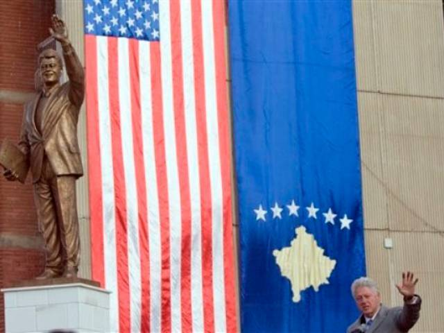 Former US President Bill Clinton attended the unveiling of a statue of himself in the capital of Kosovo, Pristina today   Photo: AFP/GETTY IMAGES
